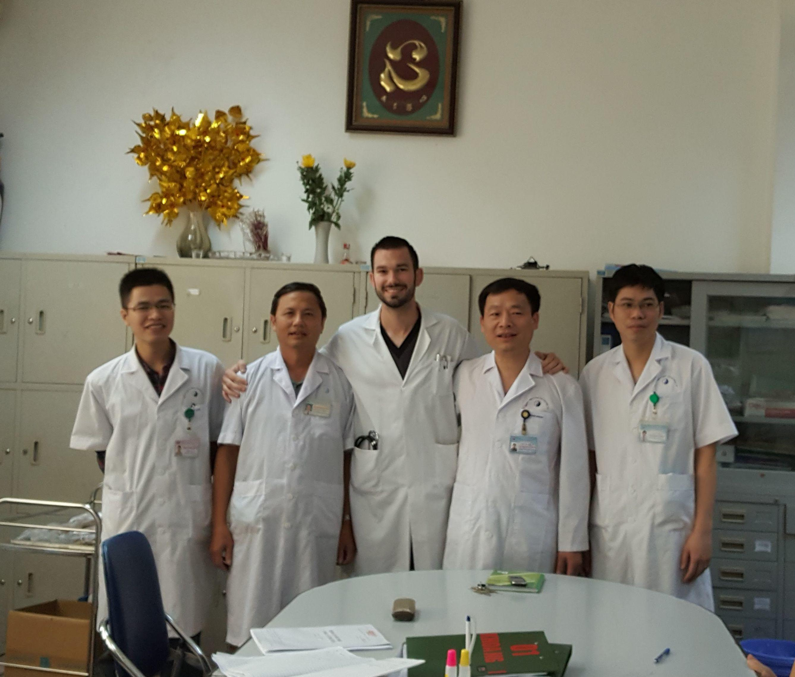 Local staff with a Projects Abroad intern at the end of his medical placement in Vietnam.